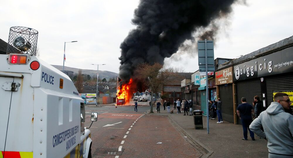A hijacked bus burns on The Shankill Road as protests continue in Belfast, Northern Ireland, April 7, 2021