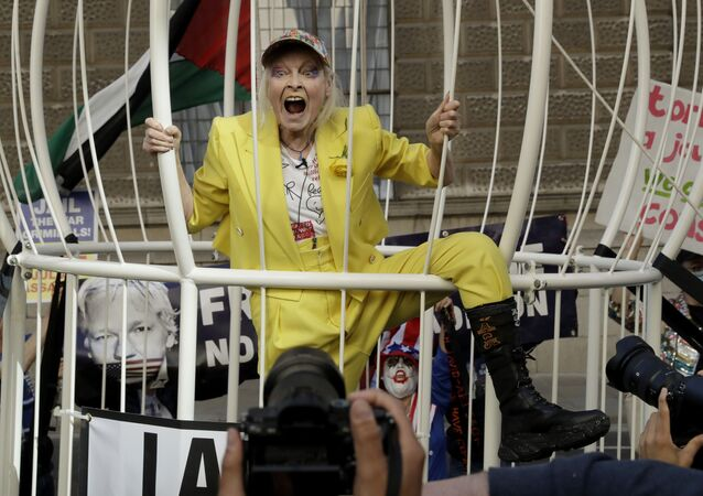 Fashion designer Vivienne Westwood stands in a giant bird cage in protest against the extradition of WikiLeaks founder Julian Assange to the US, outside the Old Bailey, in London, Tuesday, 21 July 2020.