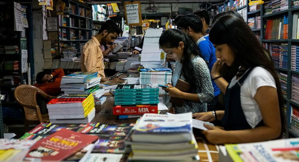 Indian students buy textbooks in New Delhi in a photograph taken on 7 April 2018.
