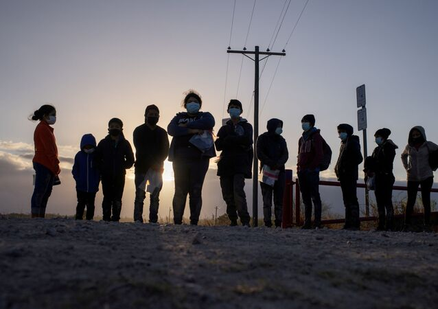 Asylum seeking migrants from Central America await transport after crossing the Rio Grande river into the United States from Mexico on a raft in Penitas, Texas, U.S., March 12, 2021