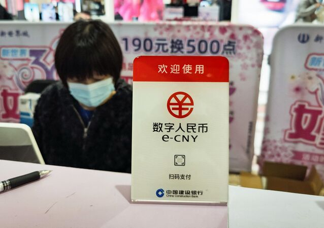A sign for China's new digital currency, electronic Chinese yuan (e-CNY) is displayed at a shopping mall in Shanghai on March 8, 2021