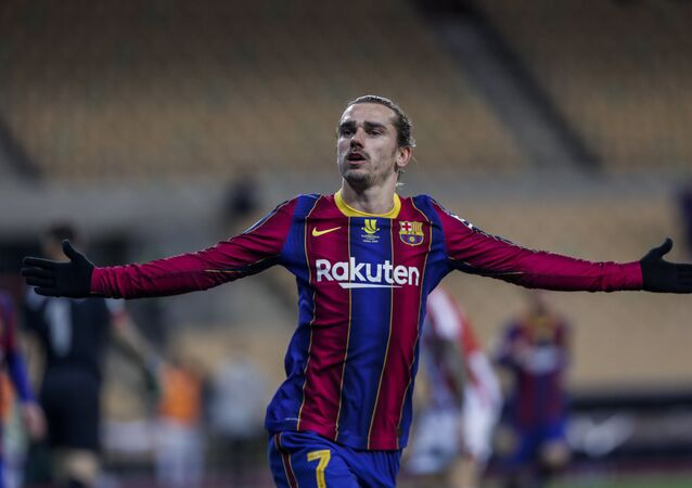 Barcelona's Antoine Griezmann celebrates after scoring his second goal during the Spanish Supercopa final soccer match between FC Barcelona and Athletic Bilbao at La Cartuja stadium in Seville, Spain, Sunday, 17 January 2021.