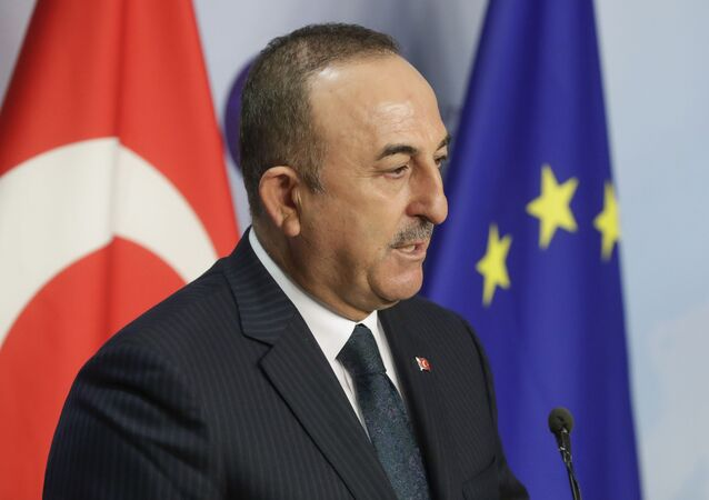 Turkey's Foreign Minister Mevlut Cavusoglu gives a joint statement with European Union foreign policy chief Josep Borrell prior to their meeting in Brussels, Thursday, Jan. 21, 2021.