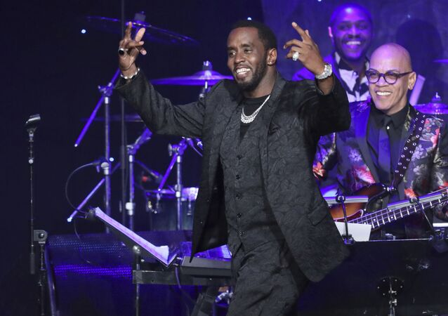 Sean Combs walks on stage to accept the 2020 Industry Icon award at the Pre-Grammy Gala And Salute To Industry Icons at the Beverly Hilton Hotel on Saturday, Jan. 25, 2020, in Beverly Hills, Calif.