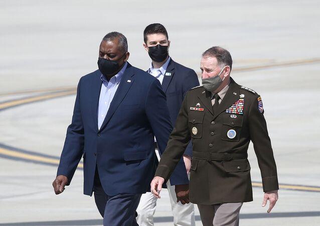U.S. Defense Secretary Lloyd Austin walks with United States Forces Korea Gen. Robert B. Abrams after arriving at Osan Air Base in Pyeongtaek, South Korea March 17, 2021