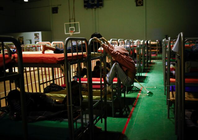 Asylum-seeking migrant children from Central America, who were expelled from the U.S. and sent back to Mexico with their families under Title 42, play on bunk beds inside the Kiki Romero temporary migrant shelter, in Ciudad Juarez, Mexico April 7, 2021