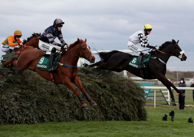 Horse Racing - Grand National Festival - Aintree Racecourse, Liverpool, Britain - April 8, 2021 Cousin Pascal ridden by James King clears the chair on their way to winning the 4:05 Rose Paterson Randox Foxhunters' Open Hunters' Chase