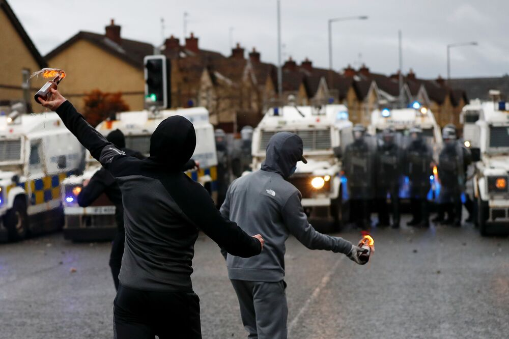 Rioters throw burning bottles at the police on the Springfield Road as protests continue in Belfast, Northern Ireland 8 April 2021.