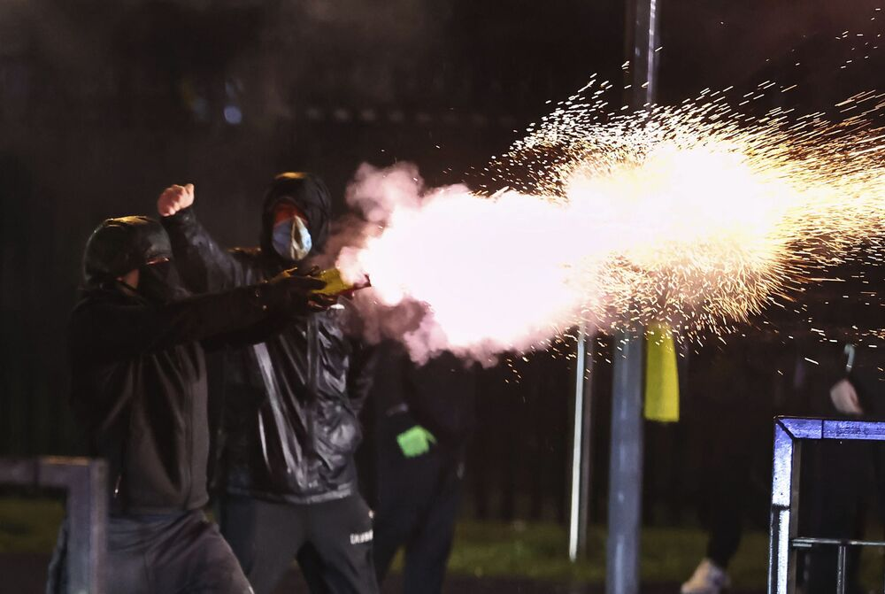 Youths shoot fireworks at the PSNI on the Springfield road, during further unrest in Belfast, Northern Ireland, Thursday, 8 April 2021. Police and politicians in Northern Ireland have appealed for calm after a third night of violence that saw Protestant youths start fires and pelt officers with bricks and gasoline bombs. The flare-ups come amid rising tensions over post-Brexit trade rules for Northern Ireland and worsening relations between the parties in the Protestant-Catholic power-sharing Belfast government.