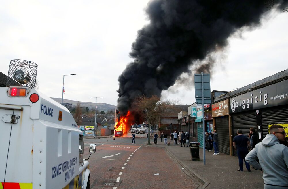 A hijacked bus burns on The Shankill Road as protests continue in Belfast, Northern Ireland, 7 April 2021.