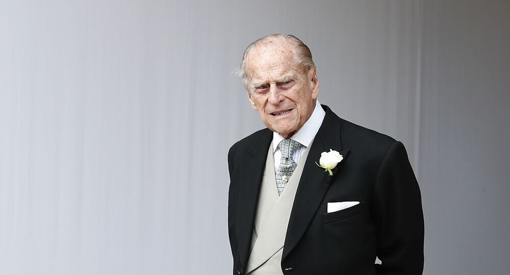 Britain's Prince Philip waits for the bridal procession following the wedding of Princess Eugenie of York and Jack Brooksbank in St George's Chapel, Windsor Castle, near London, England, Friday, Oct. 12, 2018