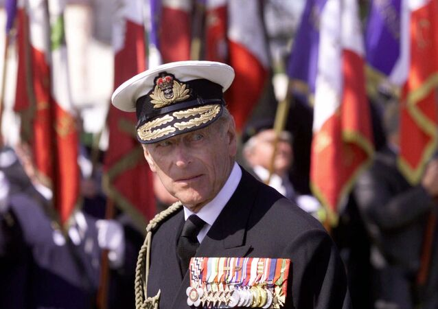 Britain's Prince Philip  appears in front of flags during a ceremony commemorating the D-Day landing in Ouistreham, Normandy, France, Tuesday June 6, 2000