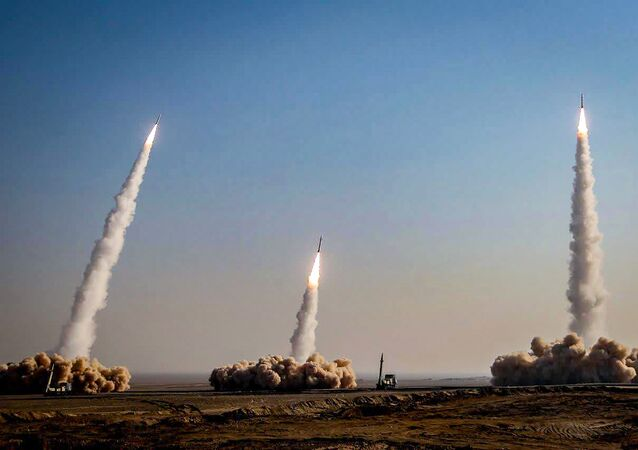 This handout photo provided by the official website of Iran's Revolutionary Guard Corps (IRGC) via SEPAH News on 15 January 2021, shows a launch of missiles during a military drill in an unknown location in central Iran.