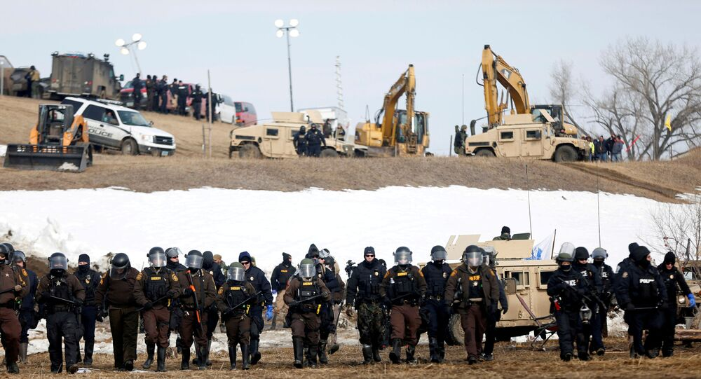 FILE PHOTO: Law enforcement officers advance into the main opposition camp against the Dakota Access oil pipeline near Cannon Ball, North Dakota, U.S., February 23, 2017.