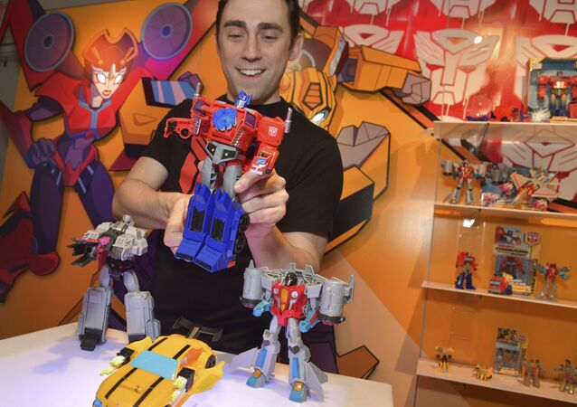A demonstrator at the Hasbro, Inc. showroom has some fun with the new TRANSFORMERS CYBERVERSE ULTIMATE CLASS OPTIMUS PRIME, converting it from vehicle to robot mode to activate his signature Matrix Mega Shot Action Attack move at American International Toy Fair on Saturday, Feb. 17, 2018 in New York.