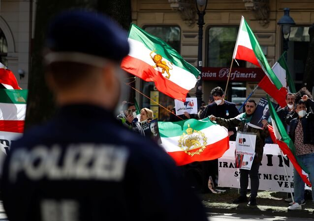 An Iranian opposition group protests outside a hotel, during a meeting of the JCPOA Joint Commission, in Vienna, Austria, April 9, 2021.