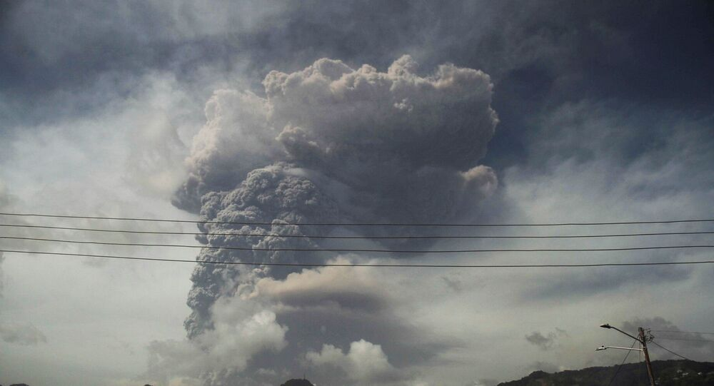 Ash and smoke billow as the La Soufriere volcano erupts in Kingstown on the eastern Caribbean island of St. Vincent on April 9, 2021.