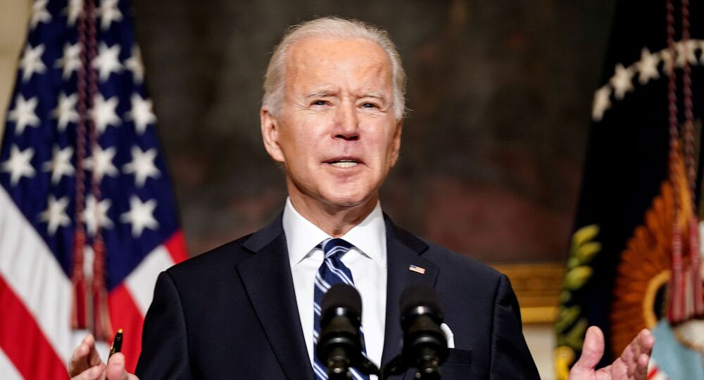 FILE PHOTO: U.S. President Joe Biden delivers remarks on tackling climate change prior to signing executive actions in the State Dining Room at the White House in Washington, U.S., January 27, 2021.