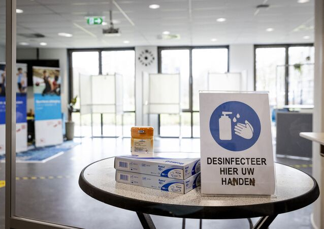 A photograph taken on March 14, 2021 shows sanitary instructions to follow while arriving at a polling station in the De Jager neighbourhood centre in Utrecht, on March 14, 2021 ahead of the parliamentary elections of March 17.