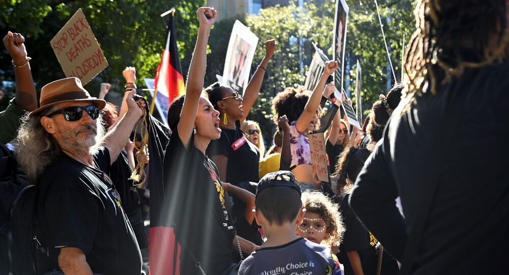 Protesters rally to mark a national day of action, protesting against Aboriginal deaths in police custody, in Sydney, Australia, April 10, 2021.