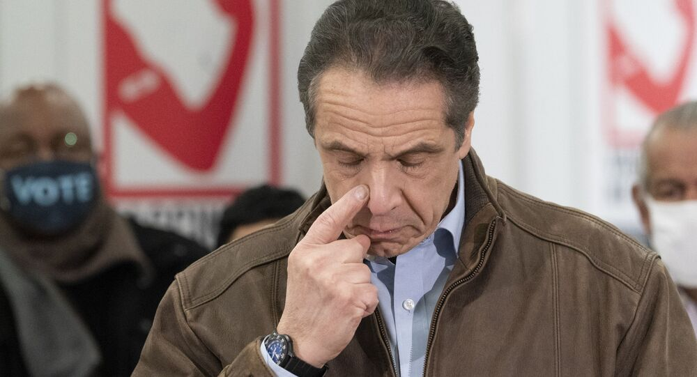New York Gov. Andrew Cuomo touches his nose during a visit to a new COVID-19 vaccination site, Monday, March 15, 2021, at the State University of New York in Old Westbury. The site is scheduled to open on Friday.