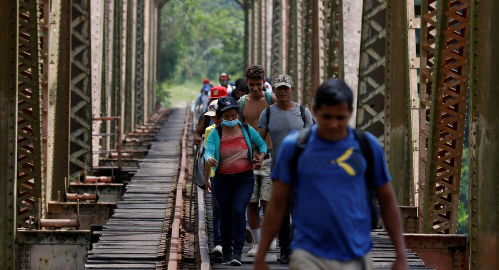 A group of migrants from Honduras walk along the railway track on their way to the United States in Huimanguillo, Tabasco, Mexico March 30, 2021