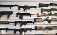 "DELRAY BEACH, FLORIDA - MARCH 24: Weapons for sale hang on the wall at WEX Gunworks on March 24, 2021 in Delray Beach, Florida. U.S. President Joe Biden has called on lawmakers to ""immediately pass"" legislation to help curb gun violence in the county."