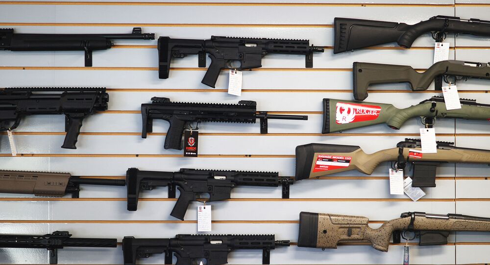 """DELRAY BEACH, FLORIDA - MARCH 24: Weapons for sale hang on the wall at WEX Gunworks on March 24, 2021 in Delray Beach, Florida. U.S. President Joe Biden has called on lawmakers to """"immediately pass"""" legislation to help curb gun violence in the county."""