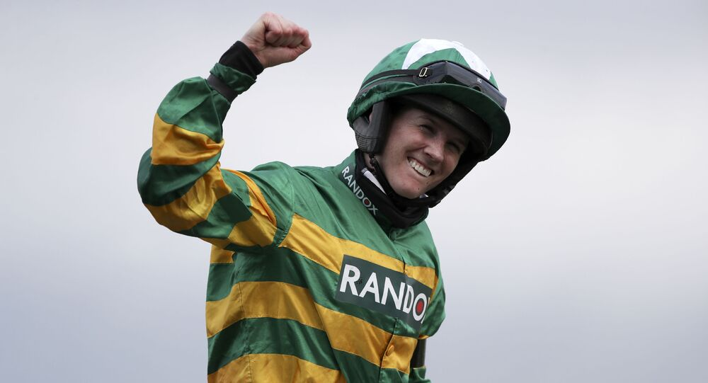 Rachael Blackmore ridding Minella Times celebrates after winning the Randox Grand National Handicap Chase on the third day of the Grand National Horse Racing meeting at Aintree racecourse, near Liverpool, England, Saturday April 10, 2021.