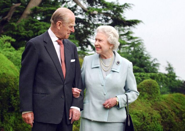 (FILES) In this file photo taken in 2007 and released 18 November 2007 shows Britain's Queen Elizabeth II and her husband, Britain's Prince Philip, Duke of Edinburgh (L) walking at Broadlands, Hampshire, earlier in the year.
