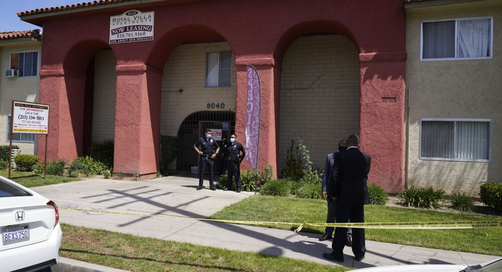Los Angeles Police investigate the scene of a crime at an apartment complex in Reseda, Calif., Saturday, April 10, 2021. A woman discovered her three grandchildren, all under the age of 5, slain inside a Los Angeles apartment Saturday morning and their mother gone, police said.  The mother of three children — all under the age of 5 — found slain inside a Los Angeles apartment Saturday morning has been arrested, police said.