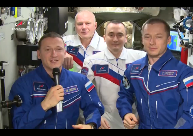 A screen shot from footage of Russian cosmonauts congratulating everyone with the 60th anniversary of Yuri Gagarin's historic space flight