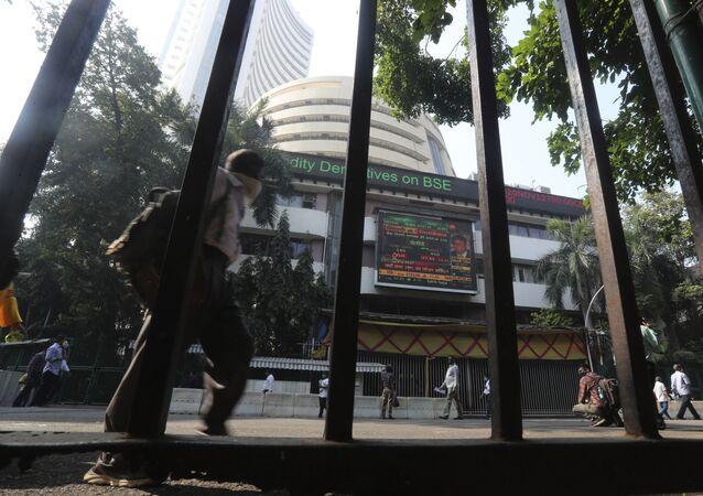 People walk past the Bombay Stock Exchange (BSE) building in Mumbai, India, Monday, Jan. 11, 2021