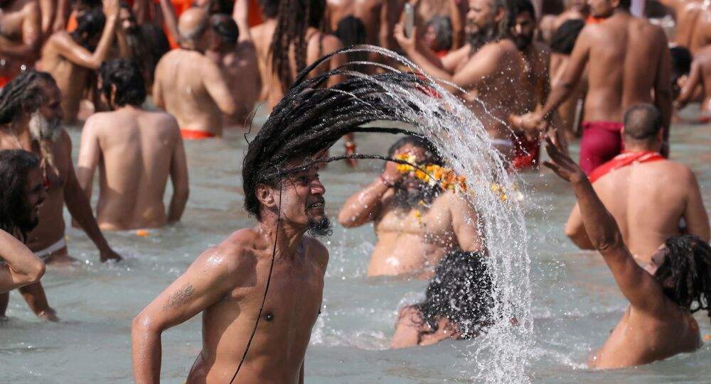 Naga Sadhus, or Hindu holy men, take a dip in the Ganges river during the first Shahi Snan at Kumbh Mela, or the Pitcher Festival, in Haridwar, India, March 11, 2021