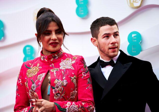 Priyanka Chopra Jonas and Nick Jonas attend the 74th British Academy Film Awards in London, Britain, April 11, 2021