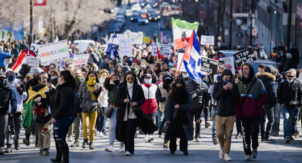 Thousands of people march in protest against Quebec's Covid-19 lockdown measures in Montreal, Canada on March 20, 2021
