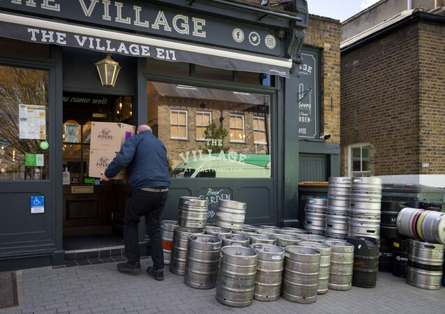 Boxes of crisps are delivered to The Village Pub in Walthamstow, northeast London on April 6, 2021, as it restocks ahead of partial re-opening on April 12 following the third Covid-19 lockdown.
