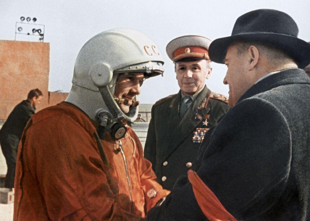 Soviet rocket engineer and spacecraft designer Sergei Korolev wishes Gagarin luck before takeoff.