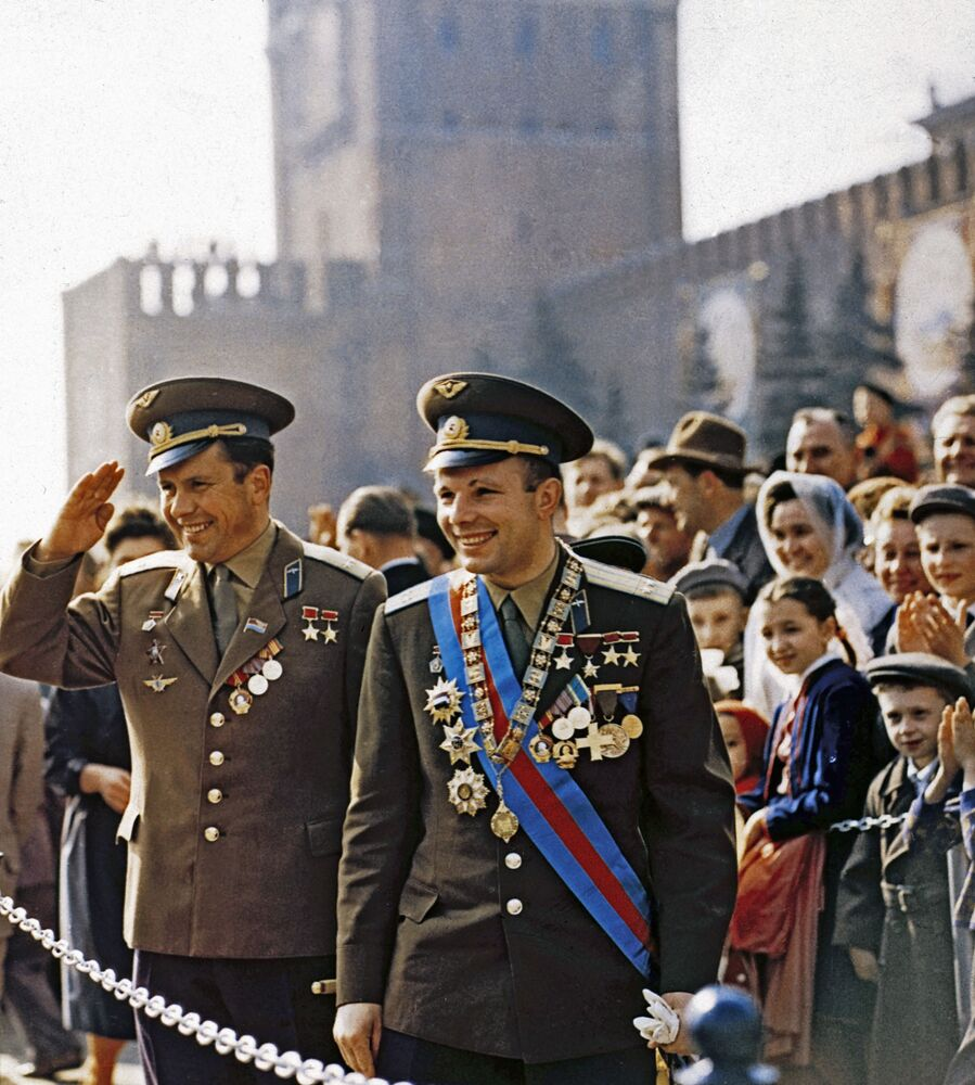 Gagarin and fellow cosmonaut Pavel Popovich (both awarded the title of Hero of the Soviet Union) are welcomed by crowds.