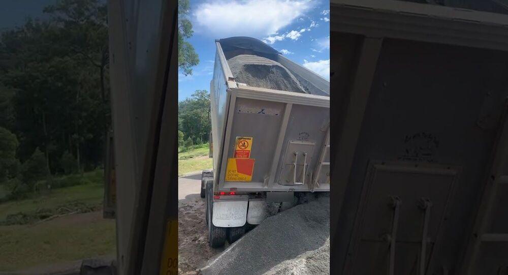 Tip Truck Trailer Topples Over While Unloading    ViralHog