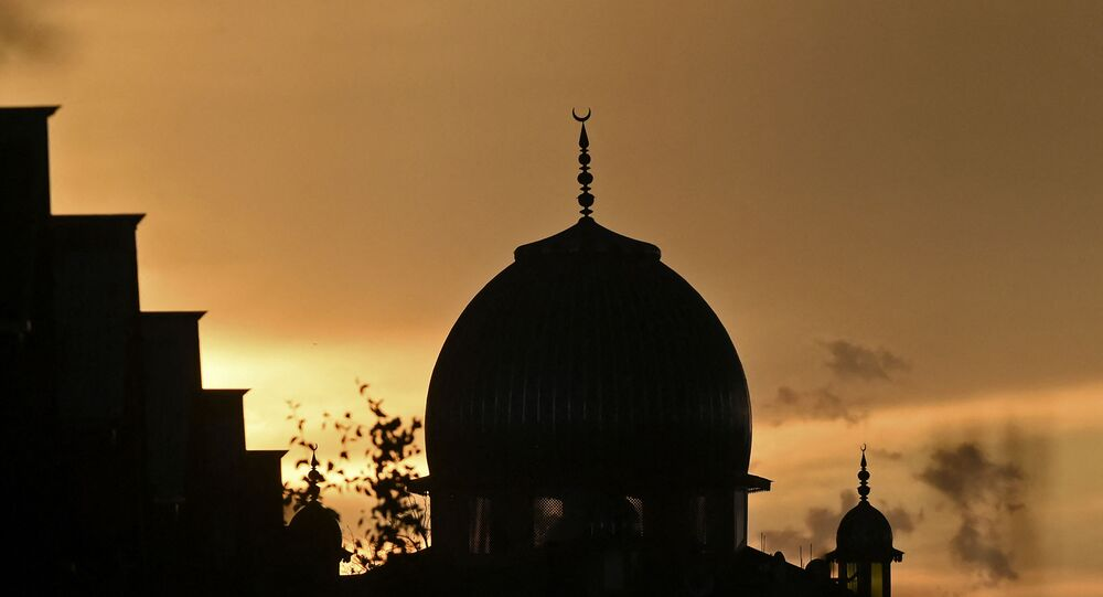 A sunset over a mosque is seen during the holy month of Ramadan in Srinagar on May 16, 2020.