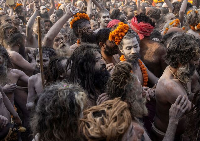 Naga Sadhus, or Hindu holy men participate in the procession for taking a dip in the Ganges river during Shahi Snan at Kumbh Mela, or the Pitcher Festival, amidst the spread of the coronavirus disease (COVID-19), in Haridwar, India, April 12, 2021