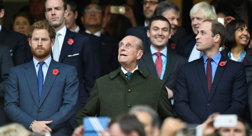 Britain's Prince Harry, Prince Philip and Prince William (L-R) attend the final of the Rugby World Cup between New Zealand and Australia at Twickenham in London, Britain, 31 October 2015.