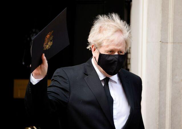 Britain's Prime Minister Boris Johnson leaves Downing Street in London, Britain, April 12, 2021