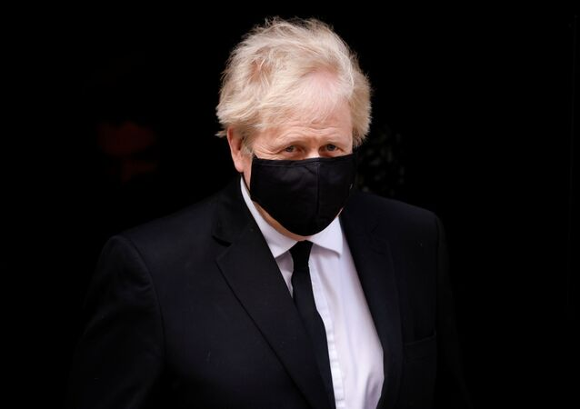 Britain's Prime Minister Boris Johnson leaves Downing Street in London, Britain, April 12, 2021