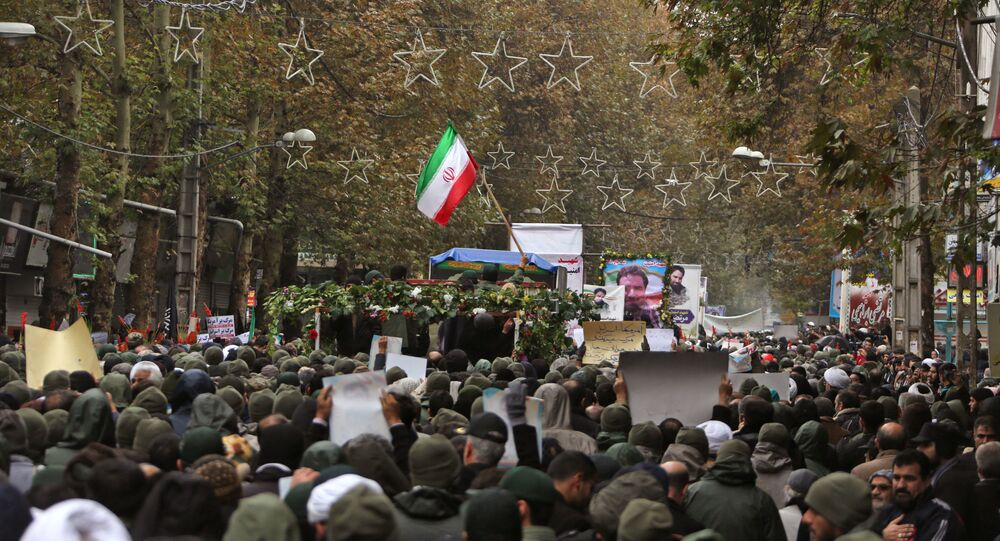 Iranian mourners attend the funeral of Morteza Ebrahimi, a commander of the Islamic Revolutionary Guard Corps, who was killed in violent demonstrations that erupted across Iran last week against a surprise petrol price hike, on November 20, 2019 in the central Iranian city of Shahriar.