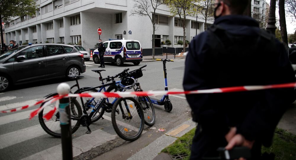 French police secure the area after one person was shot dead and one injured in front of the Henry Dunant hospital in Paris, France, April 12, 2021.