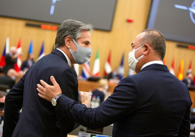 U.S. Secretary of State Antony Blinken speaks with Turkish Foreign Minister Mevlut Cavusoglu during a meeting of NATO foreign ministers at the NATO headquarters in Brussels, Belgium, March 23, 2021.