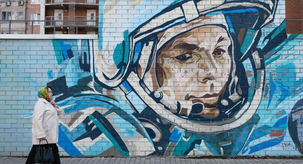A woman walks past a mural depicting cosmonaut Yuri Gagarin in Krasnogorsk, Moscow region, Russia April 11, 2021.