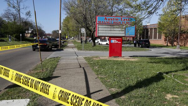 Knoxville police work the scene of a shooting at Austin-East Magnet High School Monday, April 12, 2021, in Knoxville, Tenn. - Sputnik International